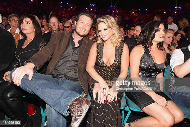 Blake Shelton kisses his wife singer Miranda Lambert attends the American Country Awards 2011 at the MGM Grand Garden Arena on December 5 2011 in Las...