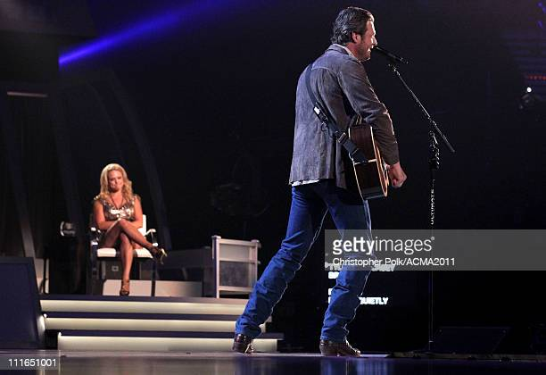 Blake Shelton performs onstage as honoree Miranda Lambert looks on during ACM Presents Girls' Night Out Superstar Women of Country concert held at...