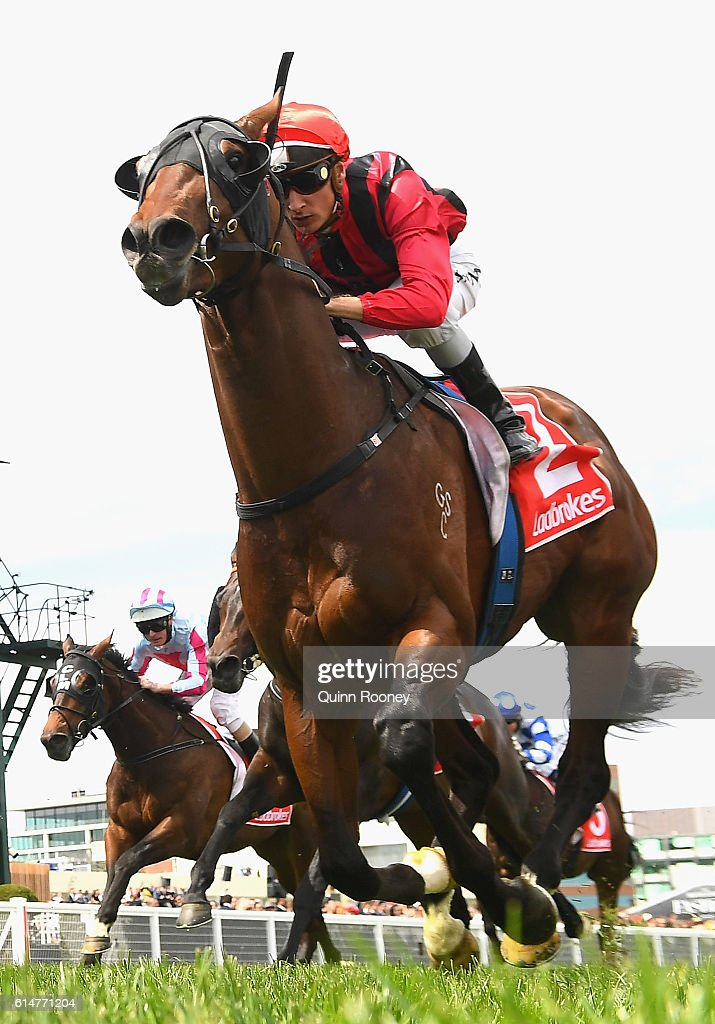 Blake Shinn riding Godd Standing crosses the line to win race 5 the Ladbrokes Classic during Caulfield Cup Day at Caulfield Racecourse on October 15, 2016 in Melbourne, Australia.