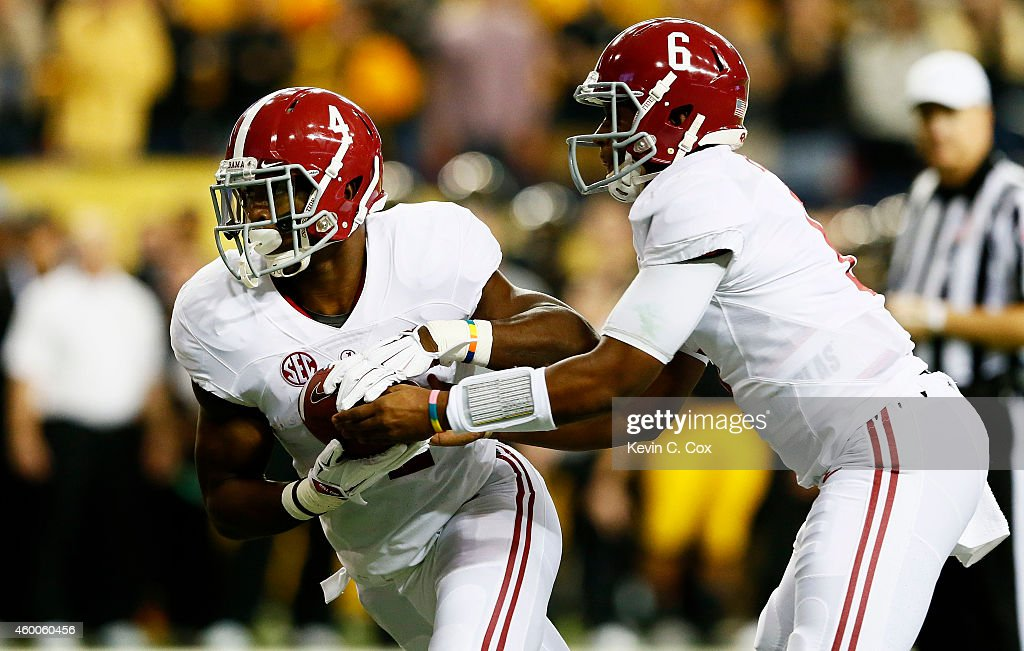 Blake Sims #6 hands off to T.J. Yeldon #4 of the Alabama Crimson Tide for a touchdown against the Missouri Tigers in the first quarter of the SEC Championship game at the Georgia Dome on December 6, 2014 in Atlanta, Georgia.
