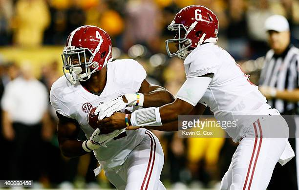Blake Sims hands off to TJ Yeldon of the Alabama Crimson Tide for a touchdown against the Missouri Tigers in the first quarter of the SEC...