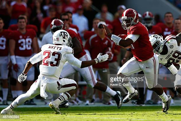 Blake Sims of the Alabama Crimson Tide breaks away from Deshazor Everett and Armani Watts of the Texas AM Aggies on the way to a touchdown at...