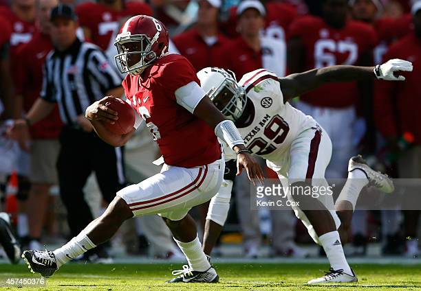 Blake Sims of the Alabama Crimson Tide breaks away from Deshazor Everett of the Texas AM Aggies on the way to a touchdown at BryantDenny Stadium on...