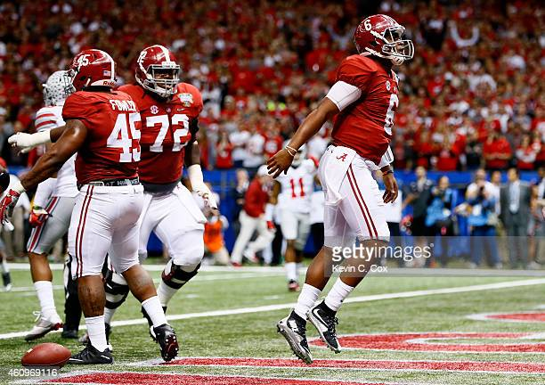 Blake Sims of the Alabama Crimson Tide celebrates after scoring a touchdown in the third quarter against the Ohio State Buckeyes during the All State...