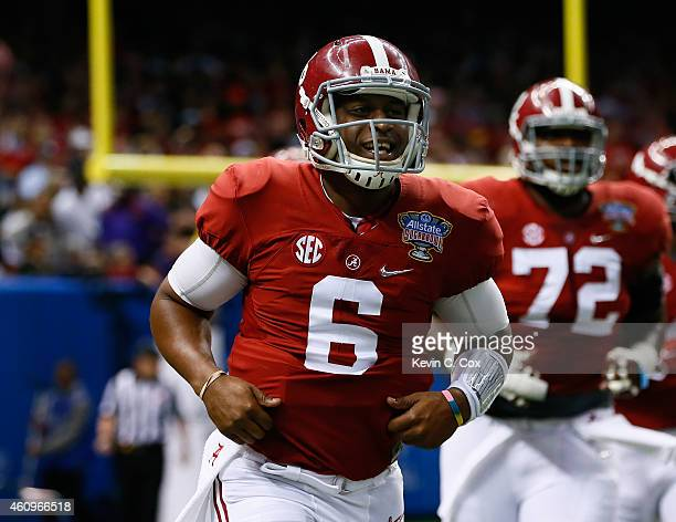 Blake Sims of the Alabama Crimson Tide celebrates after throwing 15 yard touchdown pass to Amari Cooper in the first quarter against the Ohio State...