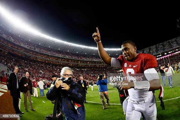 Blake Sims of the Alabama Crimson Tide celebrates as he runs off the field after defeating the Auburn Tigers in the Iron Bowl at Bryant-Denny Stadium...