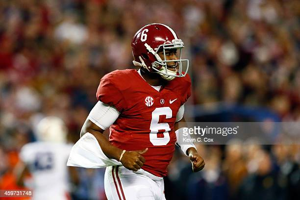 Blake Sims of the Alabama Crimson Tide celebrates the two point conversion following his touchdown in the fourth quarter against the Auburn Tigers...
