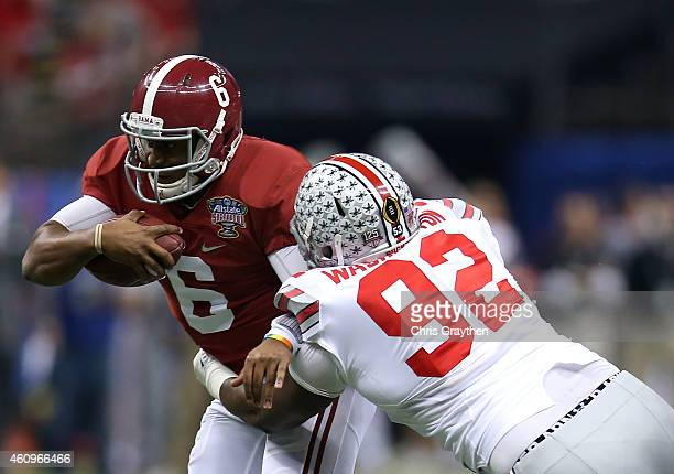 Blake Sims of the Alabama Crimson Tide gets tackled by Adolphus Washington of the Ohio State Buckeyes during the All State Sugar Bowl at the...