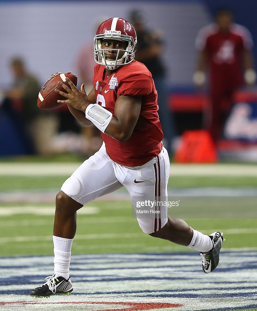 Blake Sims #6 of the Alabama Crimson Tide rolls out of the pocket against the West Virginia Mountaineers at Georgia Dome on August 30, 2014 in Atlanta, Georgia.