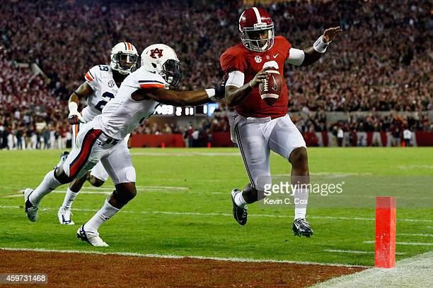 Blake Sims of the Alabama Crimson Tide runs for an 11 yard touchdown in the fourth quarter against the Auburn Tigers during the Iron Bowl at...