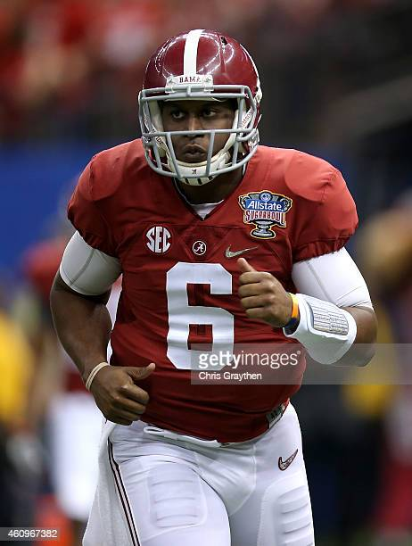 Blake Sims of the Alabama Crimson Tide walks off the field after a touchdown against the Ohio State Buckeyes during the All State Sugar Bowl at the...