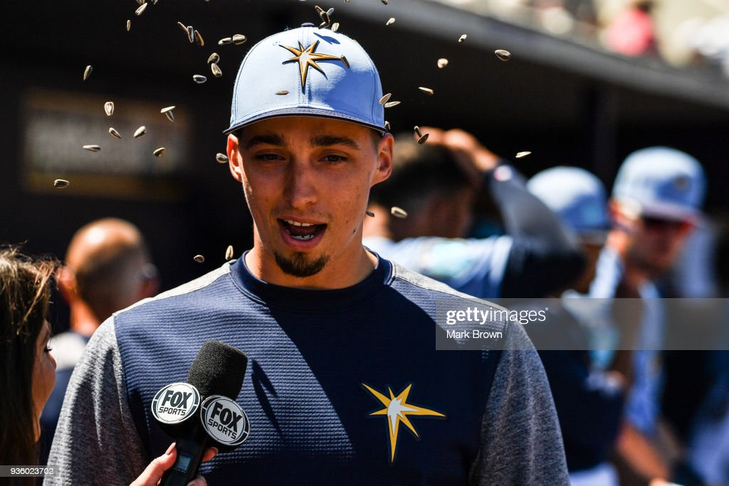 Blake Snell #4 of the Tampa Bay Rays gets seeds thrown on him during an interview in the dugout during the spring training game between the Tampa Bay Rays and the Boston Red Sox at Charlotte Sports Park on March 21, 2018 in Port Charlotte, Florida.