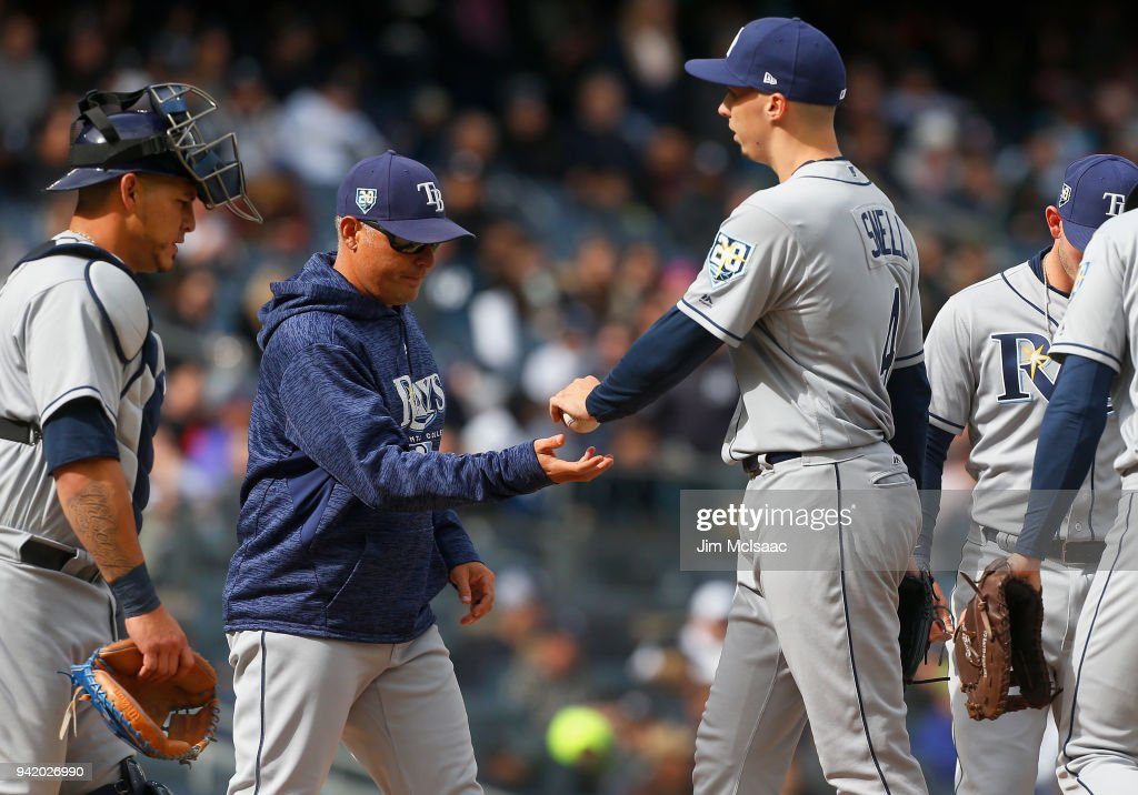 Blake Snell #4 of the Tampa Bay Rays hands the ball to manager Kevin Cash as he is removed from a game against the New York Yankees in the fourth inning at Yankee Stadium on April 4, 2018 in the Bronx borough of New York City.