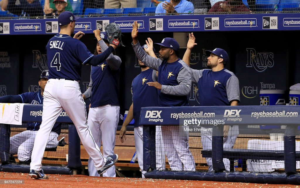 Blake Snell #4 of the Tampa Bay Rays is congratulated after coming out of the game during a game against the Texas Rangers at Tropicana Field on April 16, 2018 in St Petersburg, Florida.