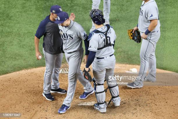 Blake Snell of the Tampa Bay Rays is taken out of the game by manager Kevin Cash during the sixth inning against the Los Angeles Dodgers in Game Six...