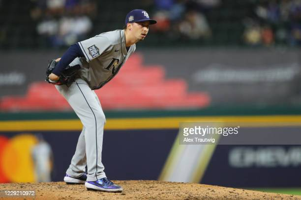 Blake Snell of the Tampa Bay Rays looks at the signs during Game 2 of the 2020 World Series between the Los Angeles Dodgers and the Tampa Bay Rays at...