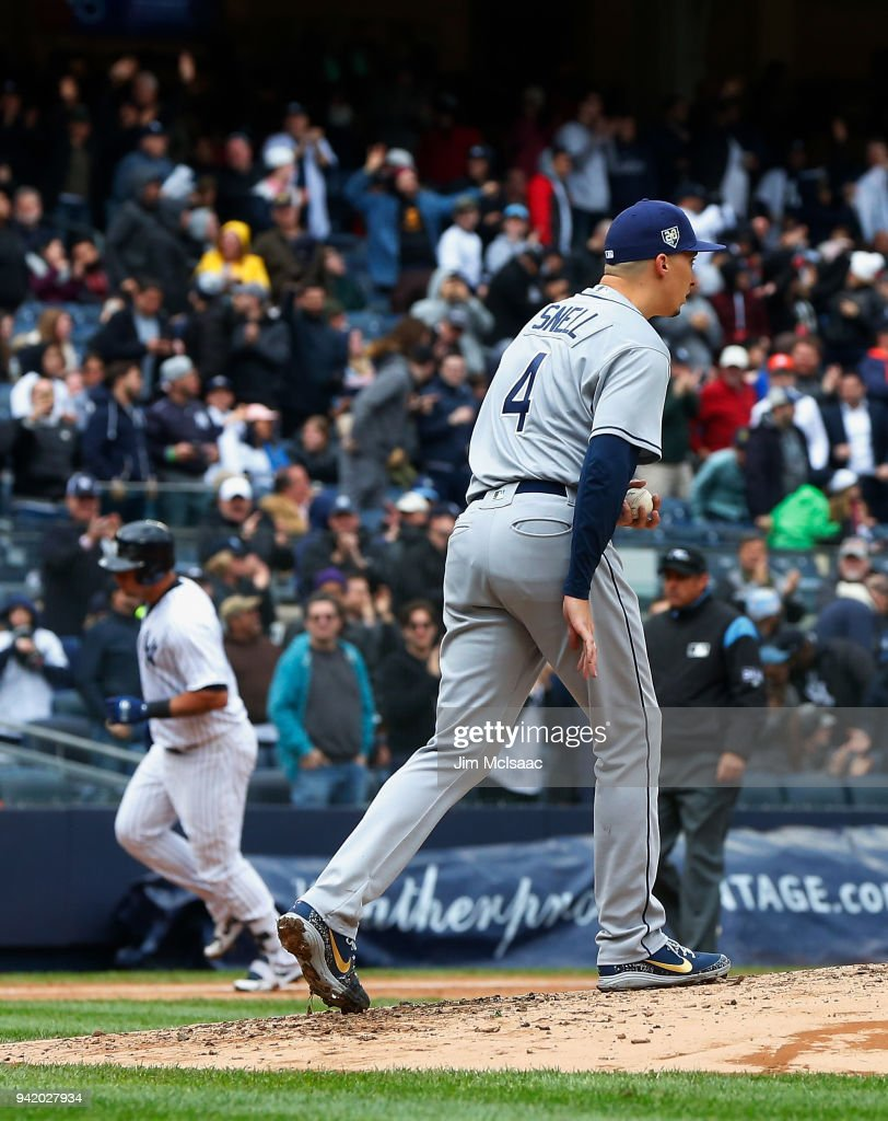 Blake Snell #4 of the Tampa Bay Rays looks on after surrendering a third inning two run home run against Gary Sanchez #24 of the New York Yankees at Yankee Stadium on April 4, 2018 in the Bronx borough of New York City.