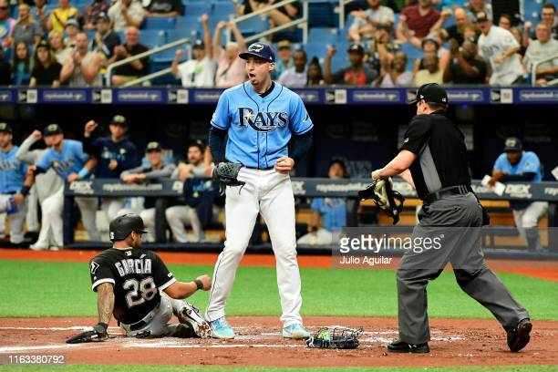 Blake Snell of the Tampa Bay Rays reacts after beating Leury Garcia of the Chicago White Sox to home plate on an attempted steal during the first...