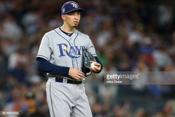 Blake Snell of the Tampa Bay Rays reacts after giving up a 3run home run in the fifth inning to Gleyber Torres of the New York Yankees at Yankee...