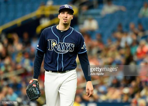 Blake Snell of the Tampa Bay Rays reacts after giving up a hit in the second inning against the Kansas City Royals on April 24 2019 at Tropicana...