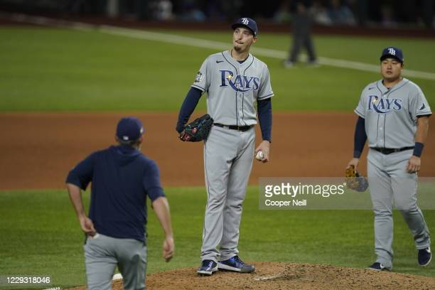 Blake Snell of the Tampa Bay Rays reacts after giving up a hit in the sixth inning of Game 6 of the 2020 World Series between the Los Angeles Dodgers...