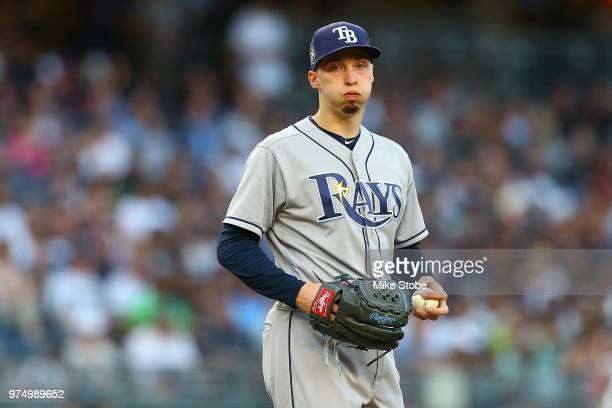Blake Snell of the Tampa Bay Rays reacts in the second inning against the New York Yankees at Yankee Stadium on June 14 2018 in the Bronx borough of...