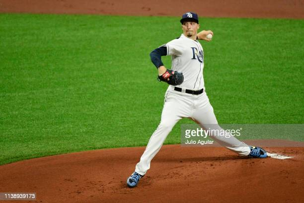 Blake Snell of the Tampa Bay Rays throws the second pitch of the season to George Springer of the Houston Astros During Opening Day at Tropicana...
