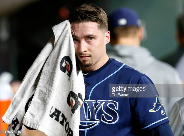 Blake Snell of the Tampa Bay Rays wipes his face in the dug out after he was relieved in the fourth inning of Game 2 of the ALDS against the Houston...