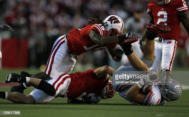 Blake Sorensen and Culmer St Jean of the Wisconsin Badgers topple Zach Boren of the Ohio State Buckeyes at Camp Randall Stadium on October 16 2010 in...