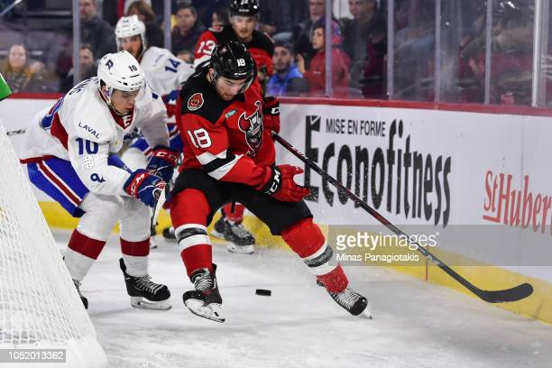Blake Speers of the Binghamton Devils and Jake Evans of the Laval Rocket skate after the puck during the AHL game at Place Bell on October 12 2018 in...