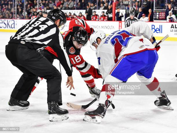Blake Speers of the Binghamton Devils and Peter Holland of the Laval Rocket faceoff during the AHL game at Place Bell on October 13 2017 in Laval...