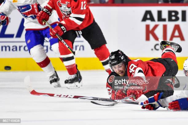 Blake Speers of the Binghamton Devils dives for the puck against the Laval Rocket during the AHL game at Place Bell on October 13 2017 in Laval...