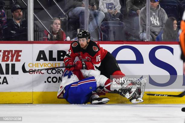 Blake Speers of the Binghamton Devils takes down Brett Lernout of the Laval Rocket during the AHL game at Place Bell on October 12 2018 in Laval...