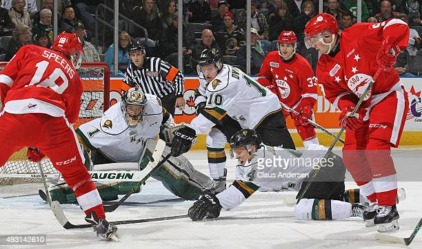 Blake Speers of the Sault Greyhounds fires a shot at Tyler Parsons of the London Knights during an OHL game at Budweiser Gardens on October 17 2015...