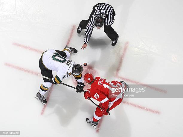 Blake Speers of the Sault Greyhounds takes a faceoff against Christian Dvorak of the London Knights during an OHL game at Budweiser Gardens on...
