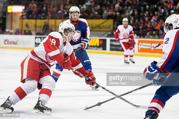 Blake Speers of the Sault Ste Marie Greyhounds moves the puck against the Windsor Spitfires on March 9 2014 at the WFCU Centre in Windsor Ontario...