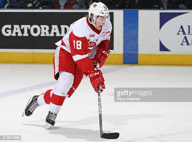 Blake Speers of the Sault Ste Marie Greyhounds skates with the puck against the London Knights during an OHL game at Budweiser Gardens on March 4...