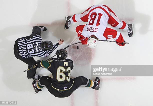 Blake Speers of the Sault Ste Marie Greyhounds takes a faceoff against Cliff Pu of the London Knights during an OHL game at Budweiser Gardens on...