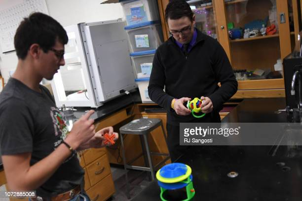 Blake Stoker a senior at Eads High School left plays with toys he helped build with a new 3D printer in Joe Wagner's science classroom on December 13...