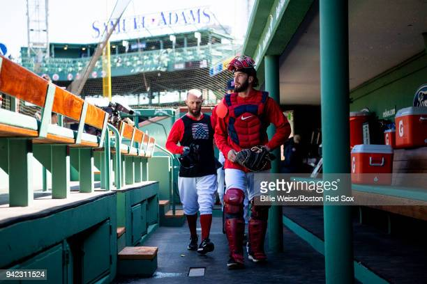 Blake Swihart and Dustin Pedroia of the Boston Red Sox walk through the dugout before the Opening Day game against the Tampa Bay Rays on April 5 2018...