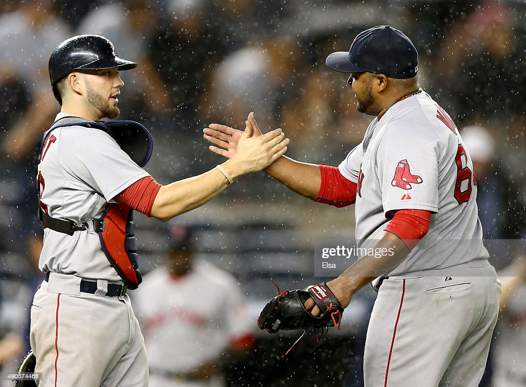 Blake Swihart #23 and Jean Machi #64 of the Boston Red Sox celebrate the win over the New York Yankees on September 29, 2015 at Yankee Stadium in the Bronx borough of New York City.The Boston Red Sox defeated the New York Yankees 10-4.