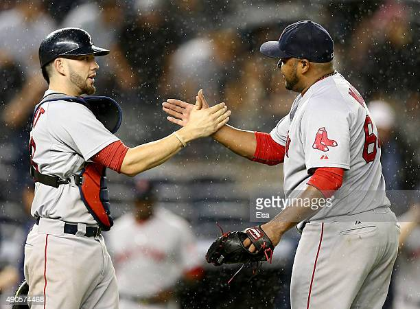 Blake Swihart and Jean Machi of the Boston Red Sox celebrate the win over the New York Yankees on September 29 2015 at Yankee Stadium in the Bronx...