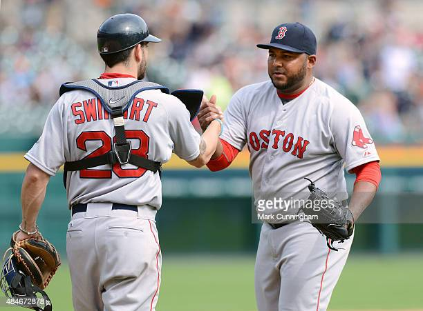 Blake Swihart and Jean Machi of the Boston Red Sox shake hands after the victory against the Detroit Tigers at Comerica Park on August 9 2015 in...