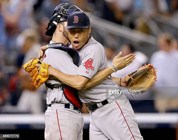 Blake Swihart and Koji Uehara of the Boston Red Sox celebrate the win over the New York Yankees on August 5 2015 at Yankee Stadium in the Bronx...