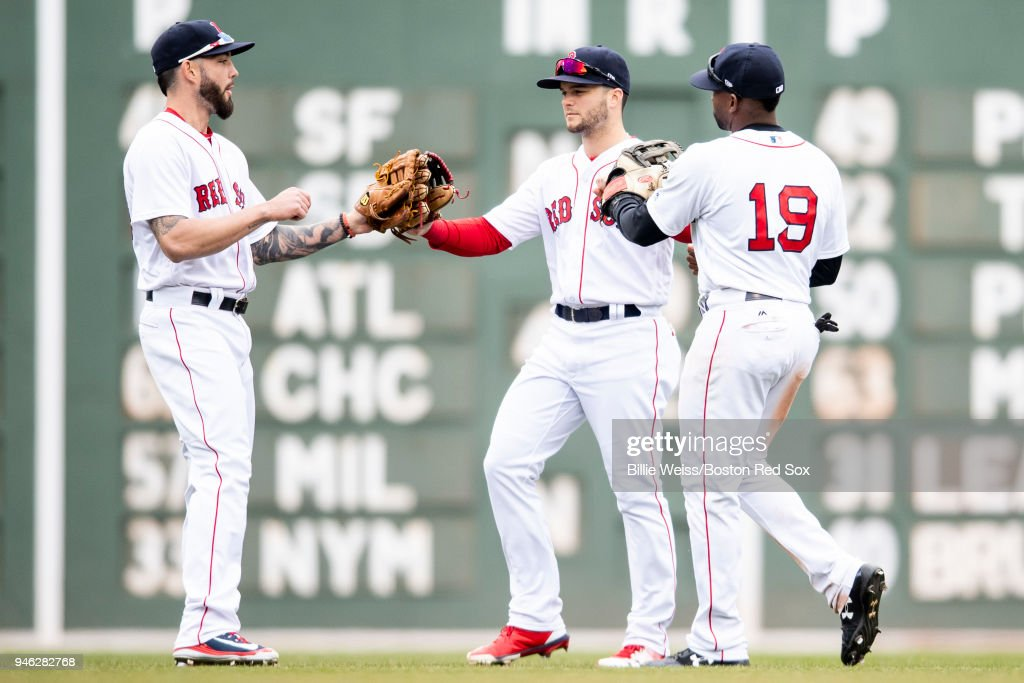 Blake Swihart #23, Andrew Benintendi #16, and Jackie Bradley Jr. #19 of the Boston Red Sox celebrate a victory against the Baltimore Orioles on April 14, 2018 at Fenway Park in Boston, Massachusetts.