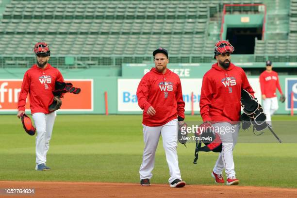 Blake Swihart Christian Vazquez and Sandy Leon of the Boston Red Sox walk to the dugout during the workout day for the 2018 World Series between the...