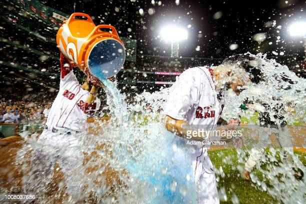 Blake Swihart is doused in Gatorade by Mookie Betts of the Boston Red Sox after hitting the gamewinning walkoff groundrule double in the thirteenth...