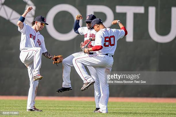 Blake Swihart Jackie Bradley Jr #25 and Mookie Betts of the Boston Red Sox celebrate a victory against the Cleveland Indians on May 22 2016 at Fenway...