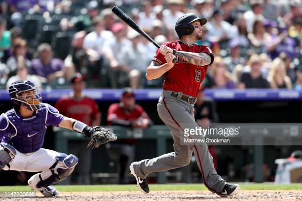Blake Swihart of the Arizona Diamondbacks hits a 2 RBI home run in the sixth inning aganst the Colorado Rockies at Coors Field on May 05 2019 in...