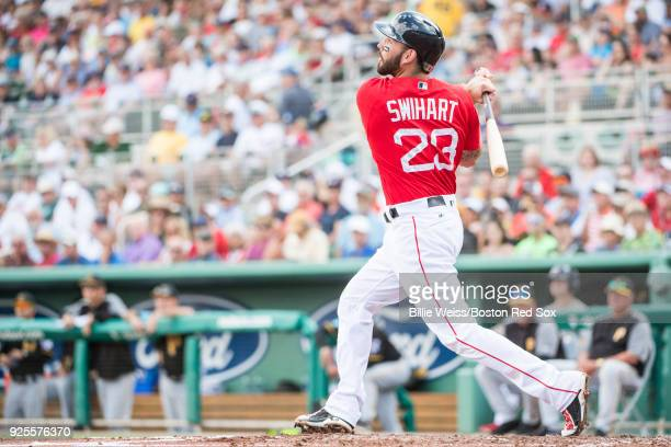 Blake Swihart of the Boston Red Sox bats during a game against the Pittsburgh Pirates at JetBlue Park at Fenway South on February 28 2018 in Fort...